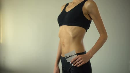 restraint : Skinny girl holding bulimia note, exhausted body needs help, eating disorder