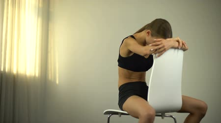 nervosa : Skinny girl sitting on chair, exhausted by malnourished, anorexia, depression.