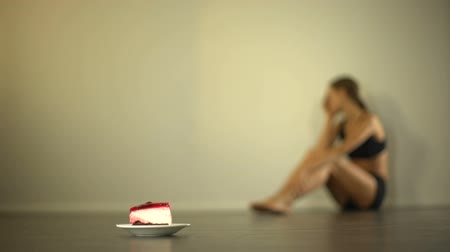 vomit : Skinny model feels nausea when looking at cake, anorexia, eating disorder