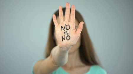 bastante : No is no inscription on womans hand, violence against women prevention, equality Stock Footage
