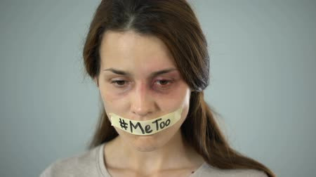 hashtag : Me too hashtag on taped mouth of woman, support for domestic violence victims Stock Footage