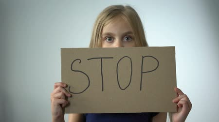 zajetí : Girl shows stop sign, social protection of children domestic violence prevention Dostupné videozáznamy
