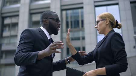 criticism : Boss shouting at office manager, woman shows stop gesture, employee rights