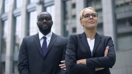 subordinate : Female leader and subordinate posing for camera, successful business people Stock Footage