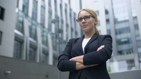 self promotion : Confident business lady taking challenge, purposeful and smart in achieving goal