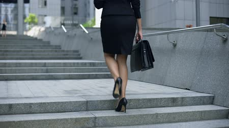 político : Business lady climbing stairs to office center, career ladder, success promotion