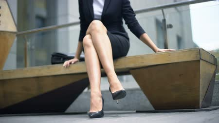 unsuccessful : Irritated businesswoman sitting on bench, nervous because of failures at work Stock Footage