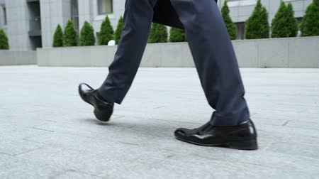 hurry up : Confident businessman walking near office center building, successful career