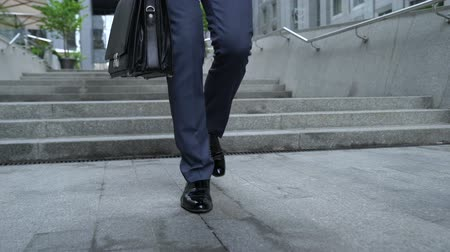 burocracia : Office manager walking down stairs, failures in work, unsuccessful interview Stock Footage