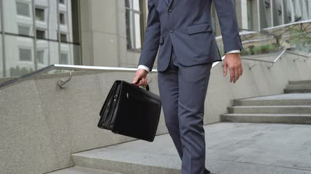 licenziamento : Frustrated businessman walking down stairs, upset for lost opportunities, fired
