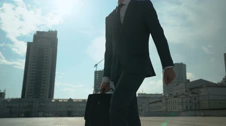 self promotion : Handsome businessman walking around city, successful and self-confident man