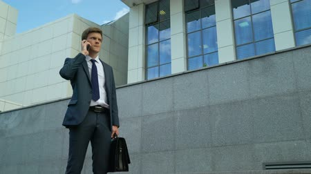 dismissal : Businessman upset about bad news after phone call, failed contract, problem Stock Footage