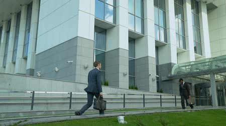 tiredness : Exhausted office worker walking near business center, suffering lack of energy