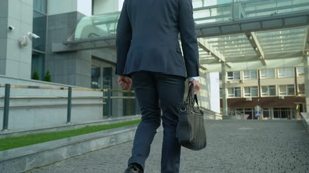 político : Happy man walking to office building, beginning of work day, successful future Archivo de Video