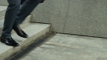 desempregado : Closeup of businessman walking downstairs, concept of setbacks in career