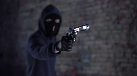 bandido : Bandit threatening with gun, gangster holding weapon, robbery, aggression Vídeos
