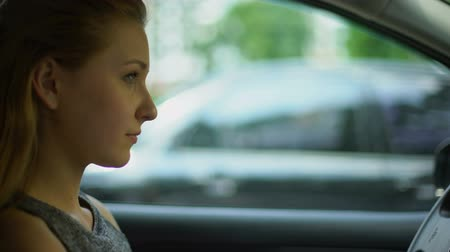thought : Woman thinking in car, making decision, young female waiting in auto, planning Stock Footage