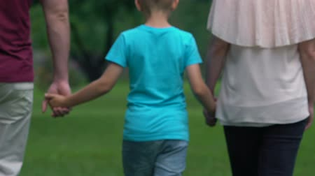 foster : Traditional family holding hands going forward after overcoming difficulties