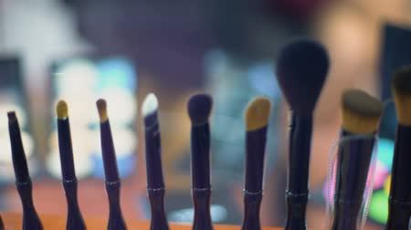 gösterileri : Set of make-up brushes close-up, fashion show backstage, cosmetics industry Stok Video
