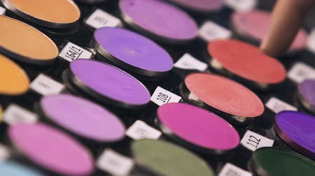 tester : Experienced salesperson advising clients combination of eye shadows colors Stock Footage