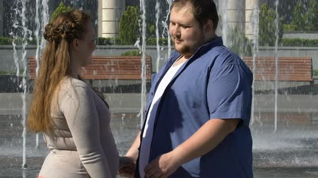 darling : Romantic couple of overweight people kissing and hugging outdoors. Stock Footage