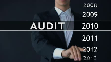 bens : Audit report 2014, businessman finds data in virtual archive financial statement Stock Footage
