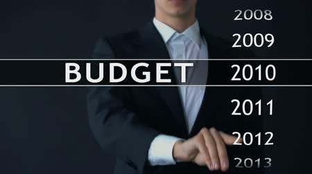 anual : 2014 budget, businessman selects file on virtual screen, annual financial report