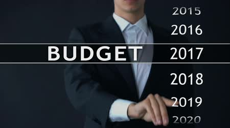 anual : 2021 budget, businessman selects file on virtual screen, annual financial report