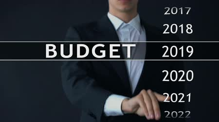 anual : 2023 budget, businessman selects file on virtual screen, annual financial report