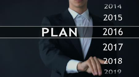 audit : Plan for 2020, businessman chooses file on virtual screen, financial strategy Stock Footage