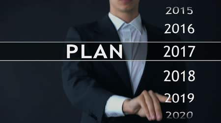 statistic : Plan for 2021, businessman chooses file on virtual screen, startup strategy Stock Footage