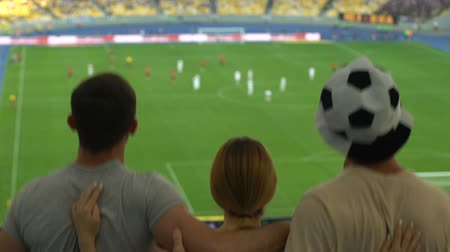арена : Soccer fans jumping watching national team during championship finals on stadium