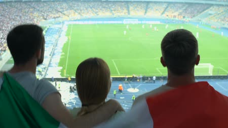 лига : Italian football fans supporting national team together, soccer match on stadium