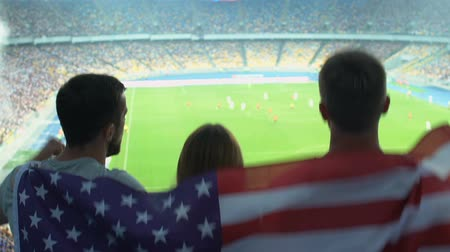 league : Cheerful American soccer fans supporting national team, championship finals