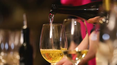 semillon : Waiter pours and shakes wine in glass, degustation, evaluation of grape variety