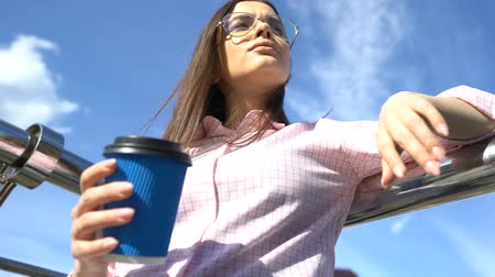 esteem : Successful student drinking coffee on campus stairs, smart and self-sufficient