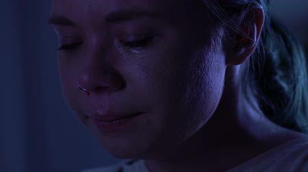 pranto : Close up portrait of crying young woman with nose bleeding, domestic violence