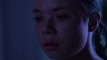 batido : Unhappy young woman crying, psychological trauma, domestic violence, closeup