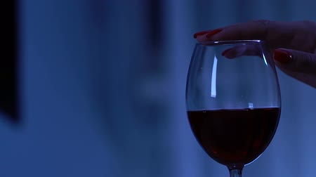 artigos de vidro : Female hand touching glass with red wine, seduction and flirt, romantic date