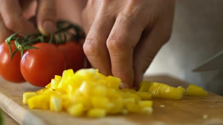 prepare food : Man slicing vegetables, preparing dinner with wife, vegetarian family traditions