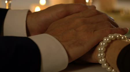 bilezik : Gentleman holding female hands, stroking tenderly, love, compassion, closeup Stok Video