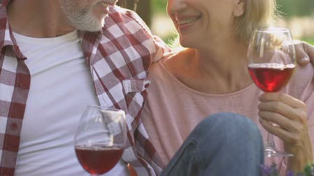 meghittség : Adult couple drinking wine outdoors, romantic date, trust and intimacy, closeup