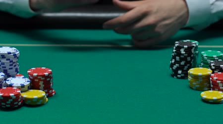 pikk : Player hand throwing pair of aces on table, win combination, poker bet, success