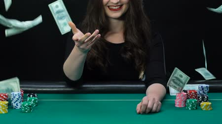 blackjack : Happy woman showing pair of aces and starting celebrate victory, money falling Stock Footage