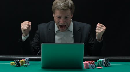 soma : Excited man sincerely rejoicing at winning big sum of money in online casino Stock Footage