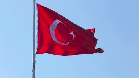 turk : Turkish flag flutters in wind in sunny day, tourism, muslim religion and culture