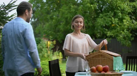 outing : Happy couple preparing for picnic in country house, healthy food, well-being