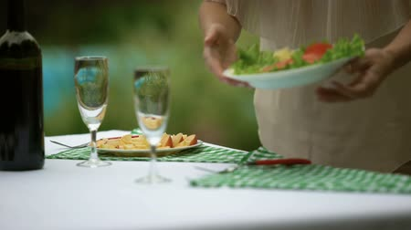 veranda : Female serving table with light snacks, celebration preparation, vegetarian food
