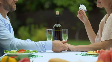 culinária : Love confession of middle-aged man on romantic dinner with woman, holding hands Stock Footage