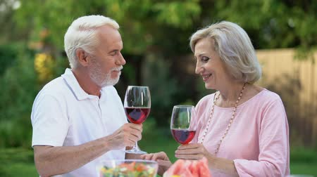 remembering : Happy old couple toasting, man complimenting beloved woman, marriage agency